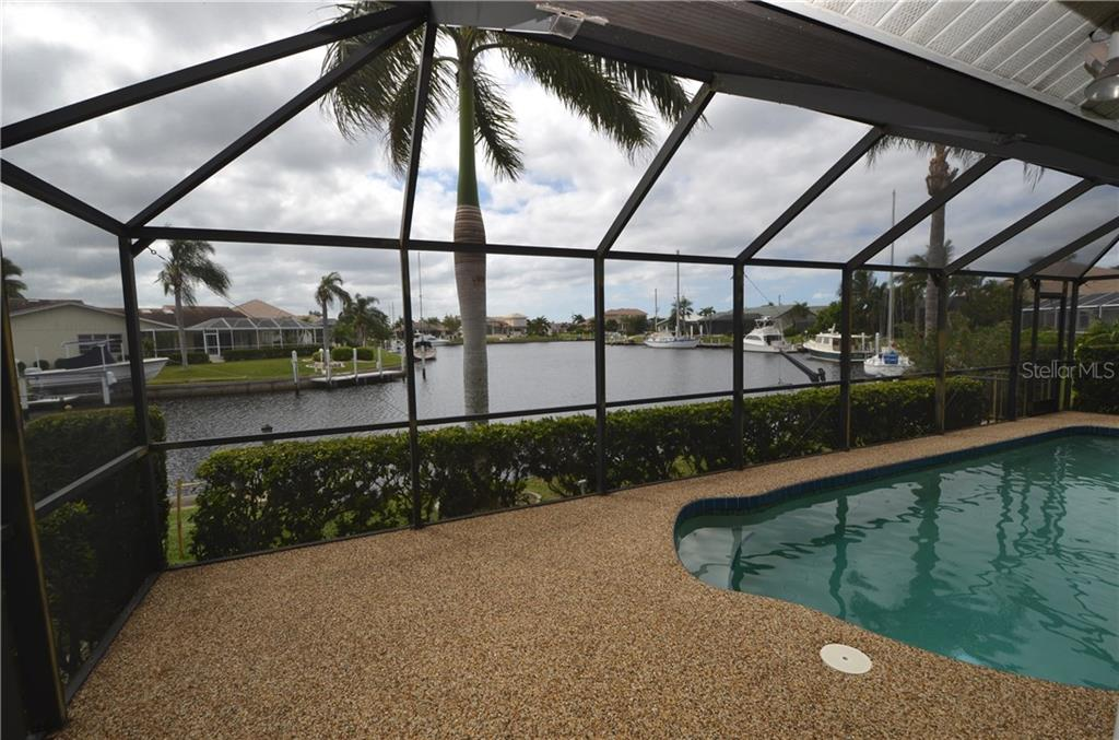 River rock pool decking - Single Family Home for sale at 2601 Parisian Ct, Punta Gorda, FL 33950 - MLS Number is C7244389