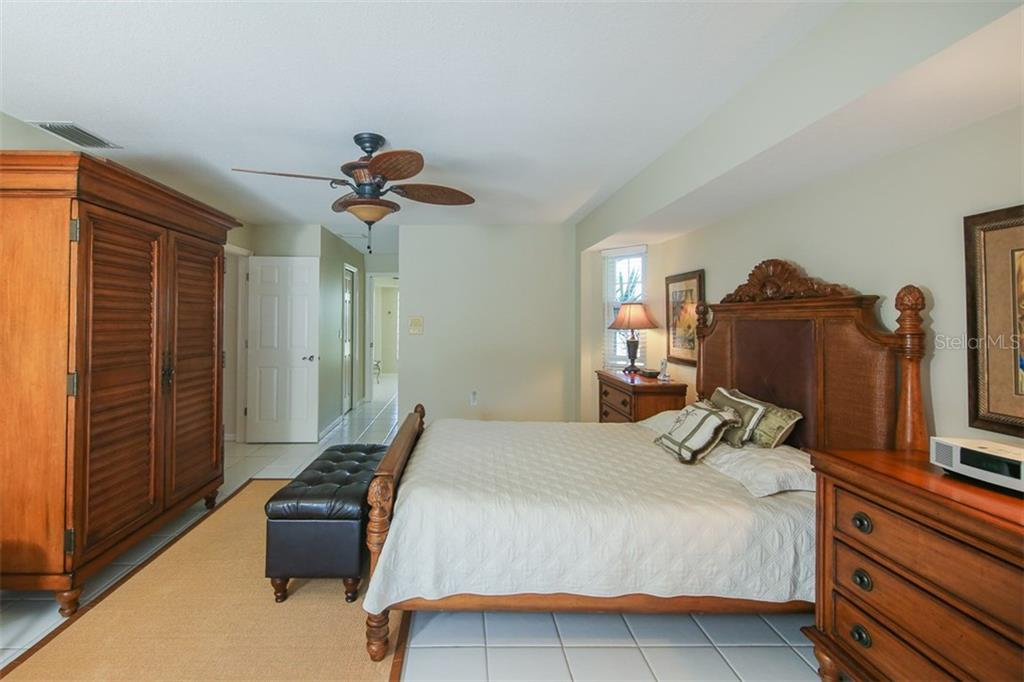 Master bedroom is spacious with plenty of room for a king bed and end tables with sliders to the outdoors - Single Family Home for sale at 4407 Albacore Cir, Port Charlotte, FL 33948 - MLS Number is C7245070