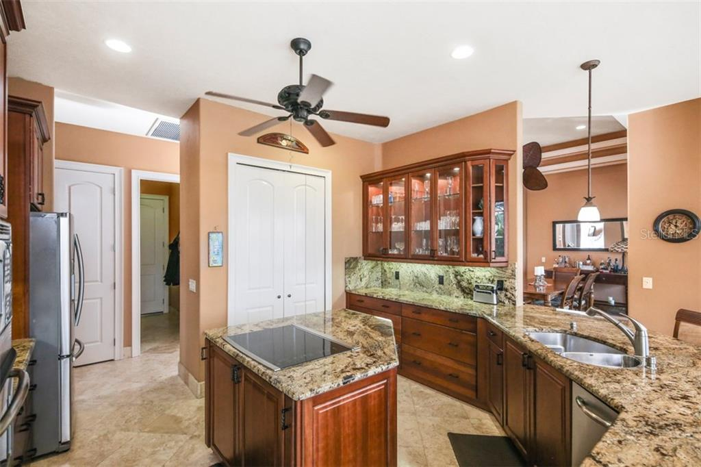 The chef will certainly appreciate the abundance of storage and drawer space along with work surfaces.  And yes, there is even a trash compactor! - Single Family Home for sale at 17208 Barcrest Ln, Punta Gorda, FL 33955 - MLS Number is C7245458