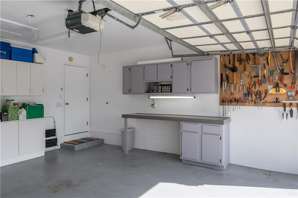 Workbench in garage and built-in cabinets for storage. - Single Family Home for sale at 2510 Rio Largo Ct, Punta Gorda, FL 33950 - MLS Number is C7246934