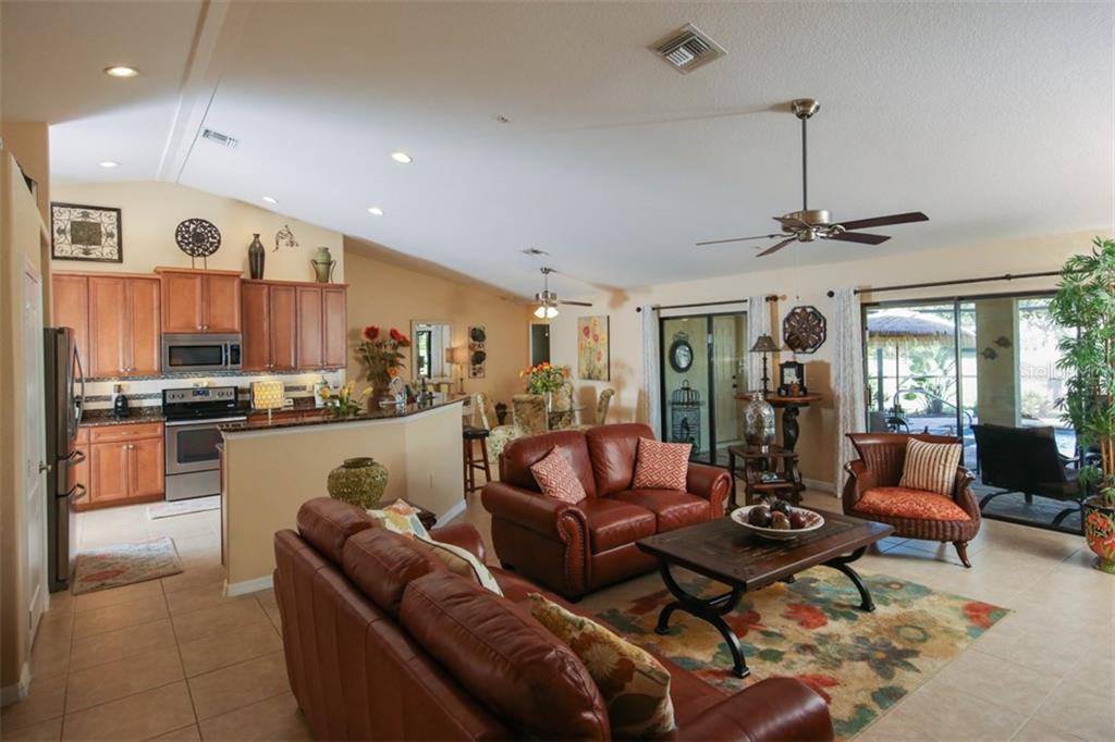 Kitchen opens to this amazing great room - perfect for entertaining family & friends - Single Family Home for sale at 220 Broadmoor Ln, Rotonda West, FL 33947 - MLS Number is C7248036