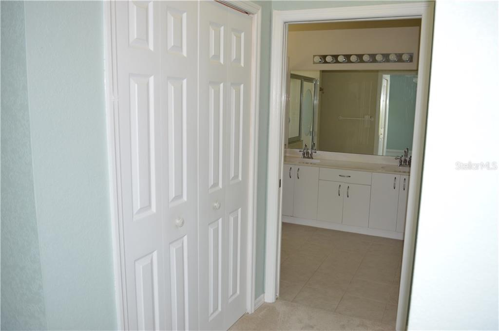 ***Master Bedroom Walk-In Closet Located In Hallway Leading To The Master Bath*** - Single Family Home for sale at 501 Islamorada Blvd, Punta Gorda, FL 33955 - MLS Number is C7248962