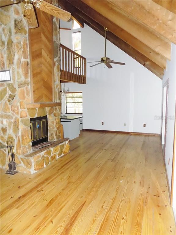 Main House Living Room w/ 2 story fireplace - Single Family Home for sale at 5624 Reisterstown Rd, North Port, FL 34291 - MLS Number is C7250923