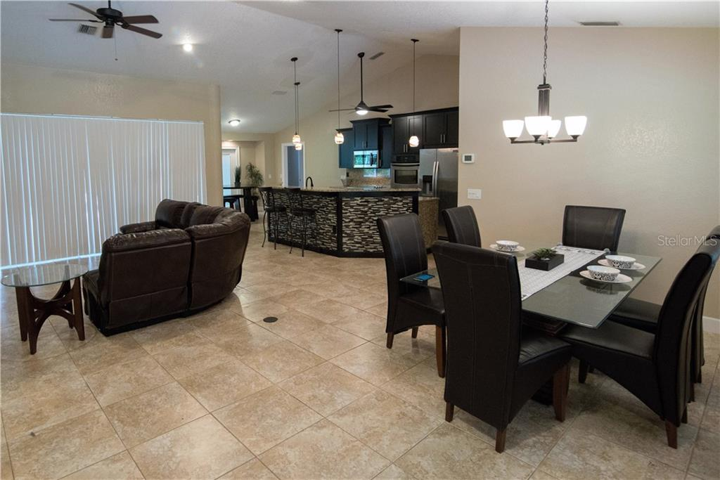 Imagine the entertaining you can do from this fabulous, well-equipped kitchen.  Your family and friends will love gathering around the breakfast bar enjoying conversation and good times with you. - Single Family Home for sale at 3184 Ulman Ave, North Port, FL 34286 - MLS Number is C7400587
