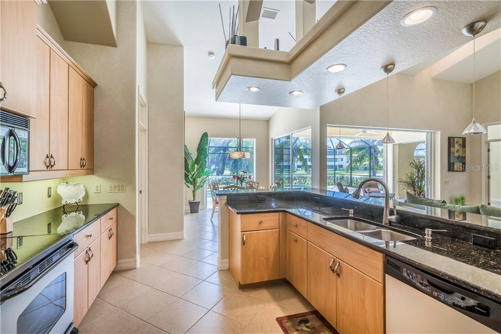 Lots of cabinets, lots of light.  Stainless appliances. - Single Family Home for sale at 931 Linkside Way, Punta Gorda, FL 33955 - MLS Number is C7400849
