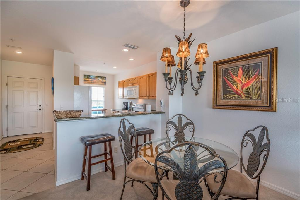 Dining and kitchen area. - Condo for sale at 8413 Placida Rd #403, Placida, FL 33946 - MLS Number is C7401304