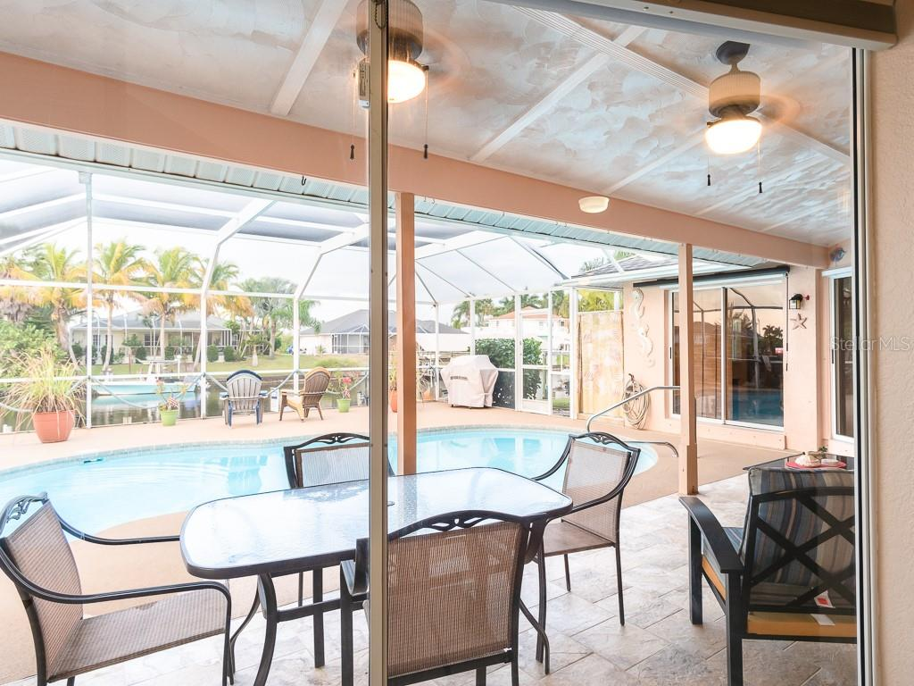 Lots of room all around the pool - did I mention the outside shower - Single Family Home for sale at 15464 Avery Rd, Port Charlotte, FL 33981 - MLS Number is C7401914
