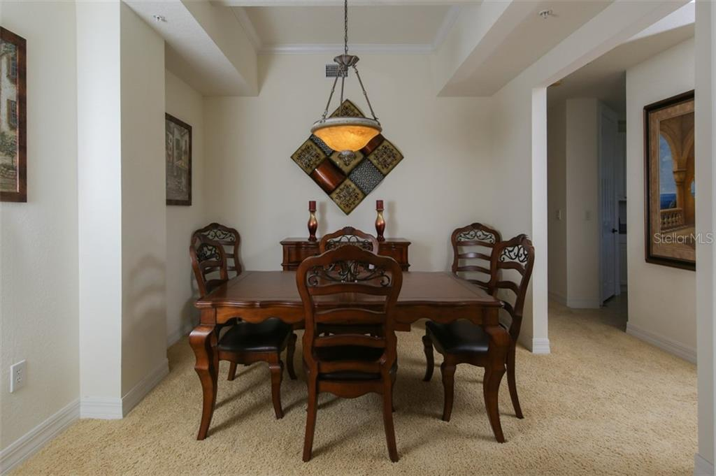 Dining room could also be used as an office or sitting room - Condo for sale at 95 Vivante Blvd #303, Punta Gorda, FL 33950 - MLS Number is C7402746