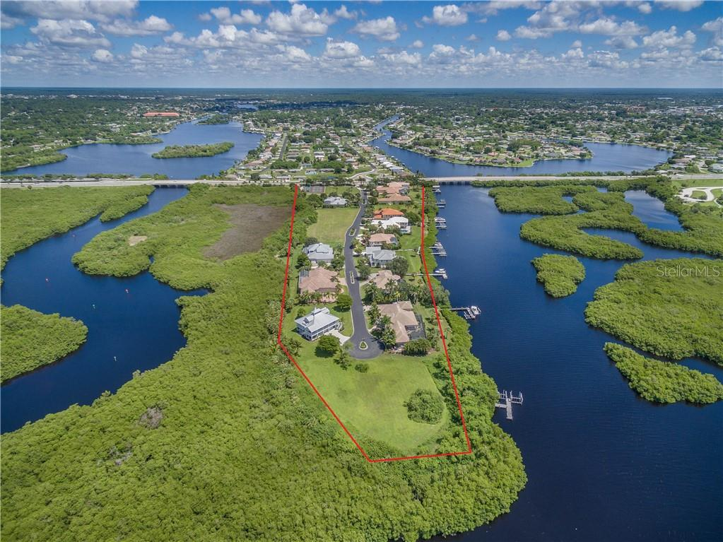 Lea Marie Island is an exclusive private subdivision situated in a natural estuary adjacent to Charlotte Harbor in beautiful Southwest Florida. Direct sailboat access from East Spring Waterway to Charlotte Harbor and on to the Gulf of Mexico makes this a very desirable place to live. All drone pictures were taken in July of 2018. - Vacant Land for sale at 4030 Lea Marie Island Dr, Port Charlotte, FL 33952 - MLS Number is C7404124