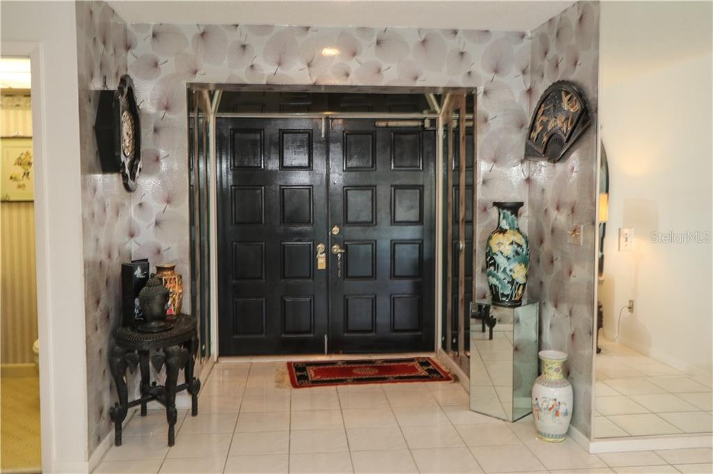 Enter through the double doors into the foyer. - Single Family Home for sale at 4449 Crews Ct, Port Charlotte, FL 33952 - MLS Number is C7405049