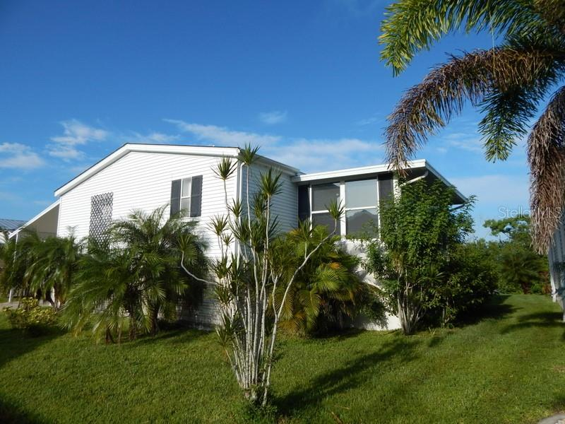 Lush tropical landscaping - Manufactured Home for sale at 66 Windmill Blvd, Punta Gorda, FL 33950 - MLS Number is C7405183