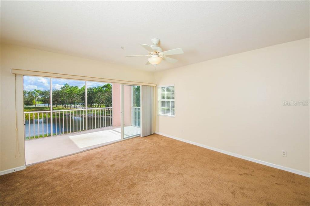 Picture perfect sliding glass wall of nature beyond. - Condo for sale at 2040 Willow Hammock Cir #b208, Punta Gorda, FL 33983 - MLS Number is C7408424