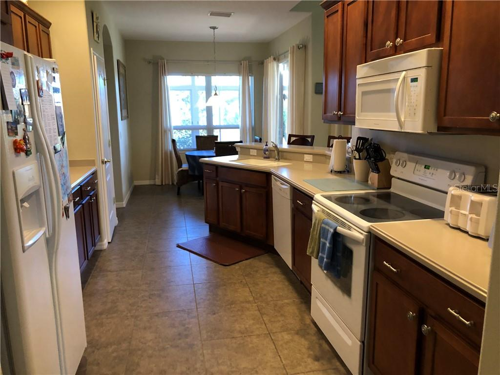 Kitchen with solid surface counter tops and wooded cabinets - Single Family Home for sale at 24380 Westgate Blvd, Port Charlotte, FL 33980 - MLS Number is C7408906