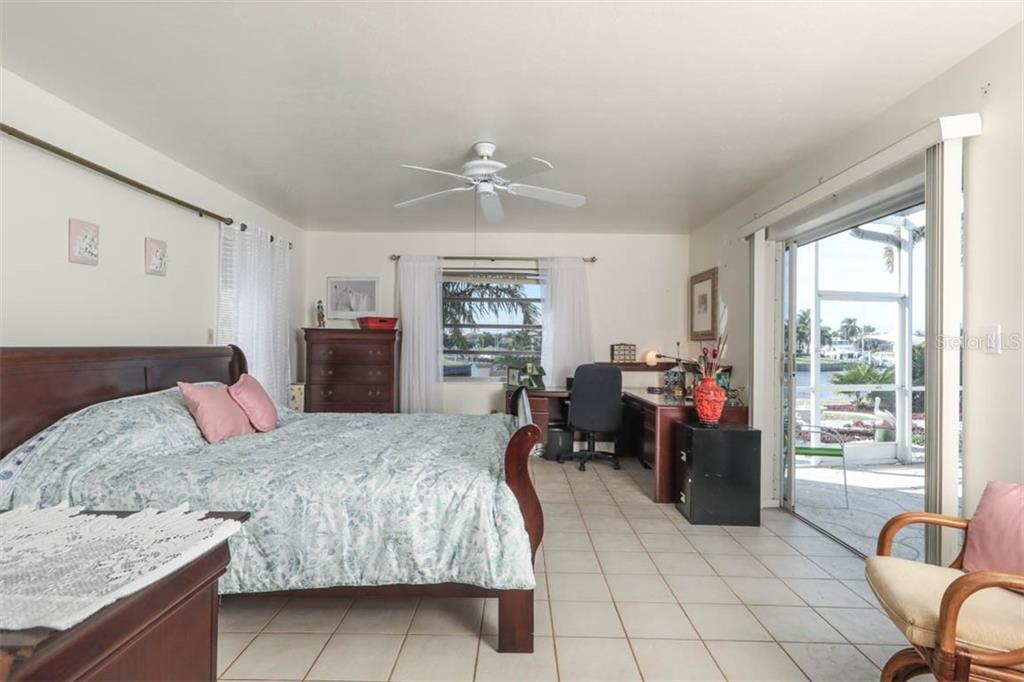 Large Owner Suite with 3 walls of windows, wide opening to pool & room for office space. - Single Family Home for sale at 2291 Bayview Rd, Punta Gorda, FL 33950 - MLS Number is C7409445