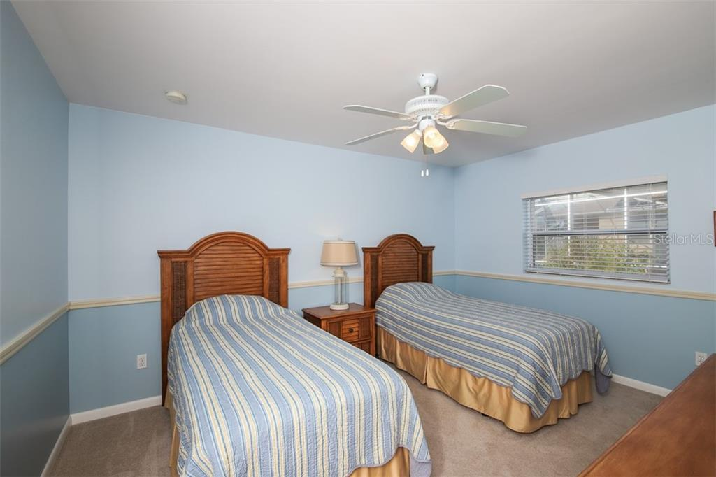 Bedroom 3 with chair rail. - Single Family Home for sale at 126 Bangsberg Rd Se, Port Charlotte, FL 33952 - MLS Number is C7409866