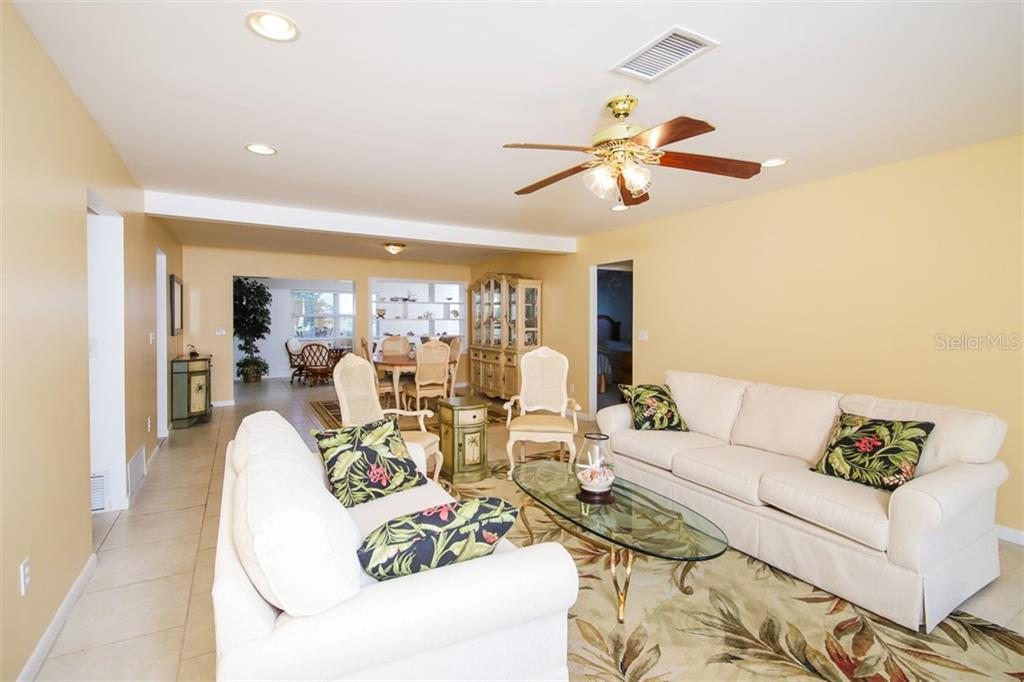 The large central living area has flexibility to arrange as works with your lifestyle. Secondary bedrooms on door to right. - Single Family Home for sale at 126 Bangsberg Rd Se, Port Charlotte, FL 33952 - MLS Number is C7409866
