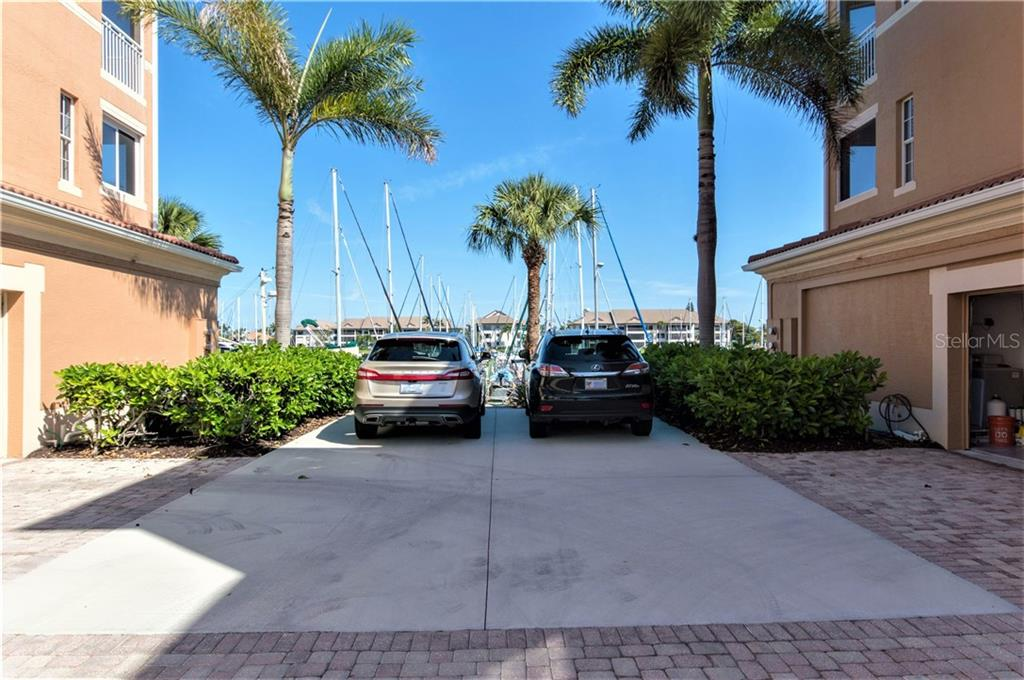 East pool with outside shower, rest rooms, and plenty of deck space for soaking up the Florida sun. - Condo for sale at 3461 Sunset Key Cir #102, Punta Gorda, FL 33955 - MLS Number is C7413196