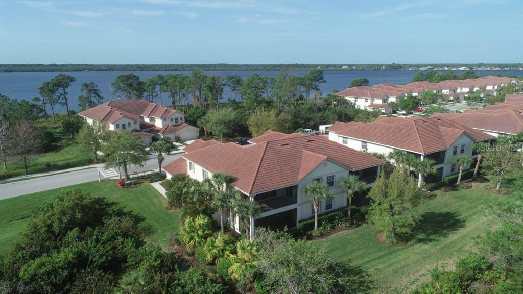 Aerial showing condo bottom left.  Myakka River opposite.  Tarpon Harbor condos also has a dock to the right with a place to take your kyaks and explore the river! - Condo for sale at 4643 Club Dr #102, Port Charlotte, FL 33953 - MLS Number is C7413207