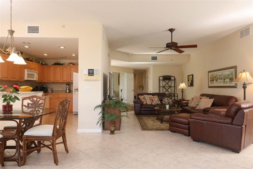 View of dining nook, kitchen, and great room from lanai - Condo for sale at 4643 Club Dr #102, Port Charlotte, FL 33953 - MLS Number is C7413207