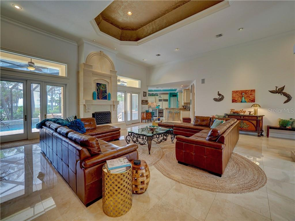 Great Room with soaring 20' ceiling and marble flooring throughout home. - Single Family Home for sale at 6150 Manasota Key Rd, Englewood, FL 34223 - MLS Number is C7415176