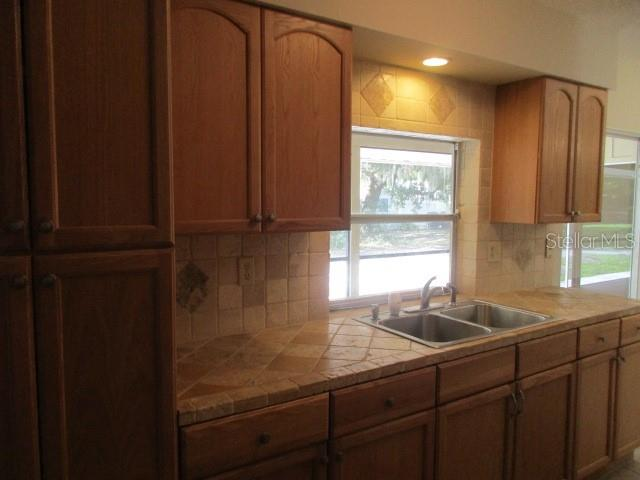 PASS THROUGH WINDOW TO LANAI HAS SAME COUNTERTOP IN LANAI AREA - Single Family Home for sale at 925 Tropical Ave Nw, Port Charlotte, FL 33948 - MLS Number is C7417107