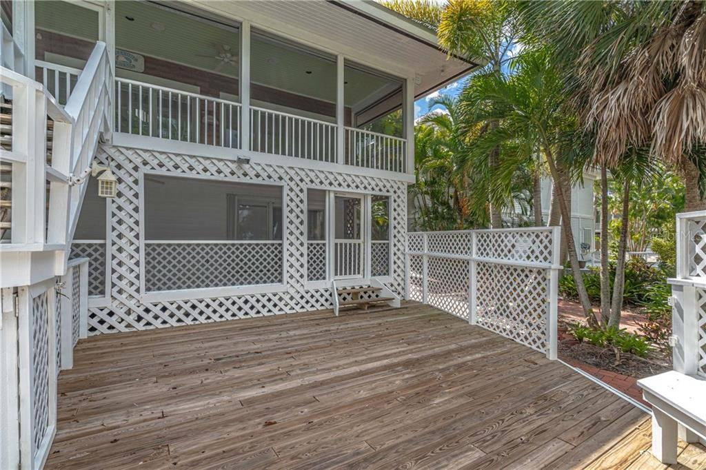 Recent addition of a back deck with built in seating. - Single Family Home for sale at 124 Useppa Is, Captiva, FL 33924 - MLS Number is C7419408