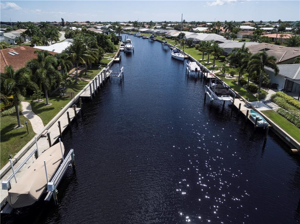 Nice wide canals- looking south down Blue Lagoon canal - Vacant Land for sale at 53 Tropicana Dr, Punta Gorda, FL 33950 - MLS Number is C7420346