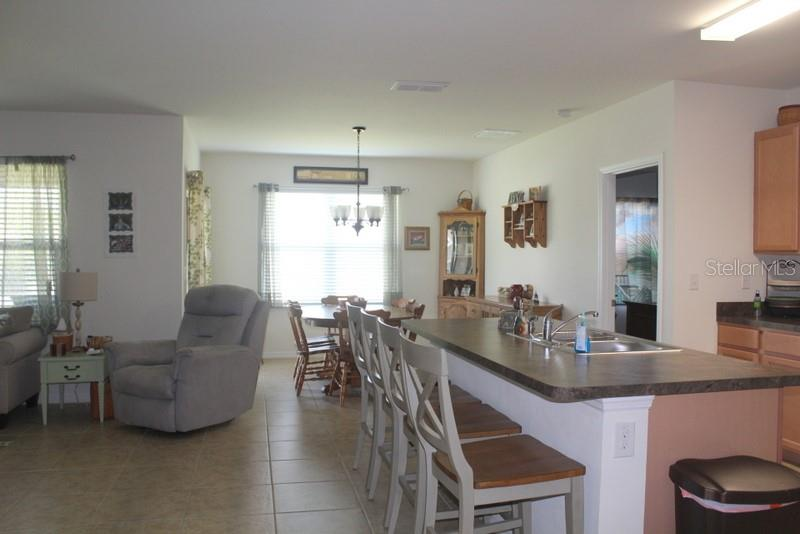 Seeing the kitchen, dining room and the living room - Single Family Home for sale at 25000 Lalique Pl, Punta Gorda, FL 33950 - MLS Number is C7421067