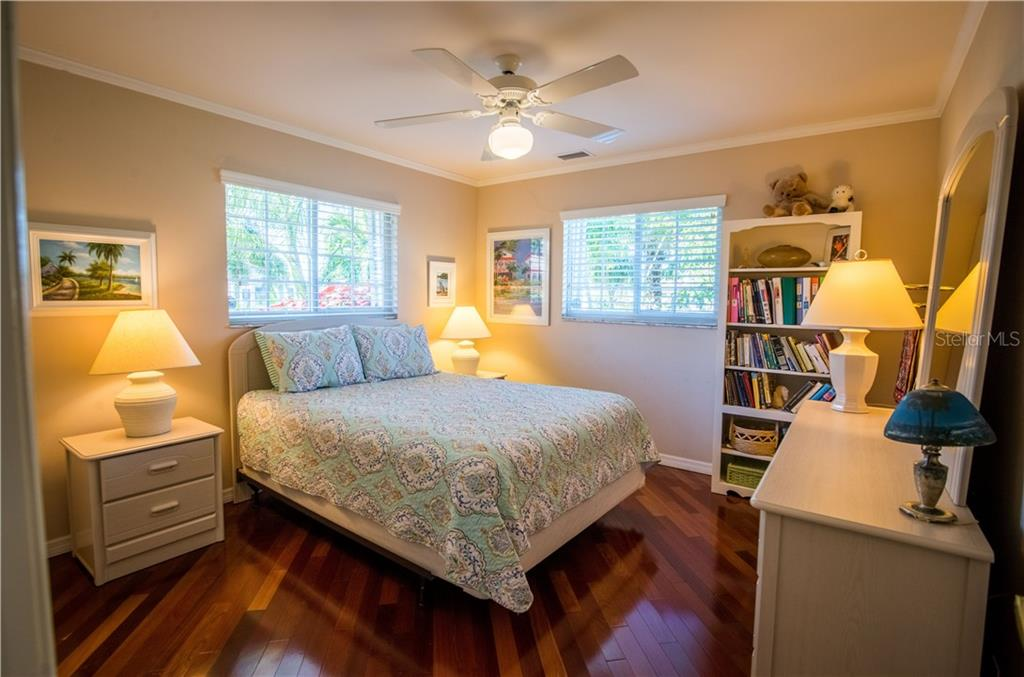 This guest bedroom is bright and light and shares a guest bath with jetted tub and shower. - Single Family Home for sale at 1440 Appian Dr, Punta Gorda, FL 33950 - MLS Number is C7425399