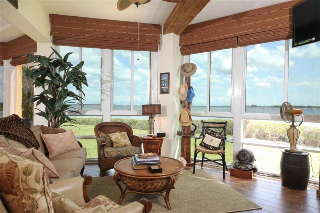 Shown in the previous photo, this area of the Florida/Great room was used as a reading/sitting area - a great place to ponder the day's activities while watching Mother Nature at work. - Condo for sale at 4410 Warren Ave #511, Port Charlotte, FL 33953 - MLS Number is C7432222