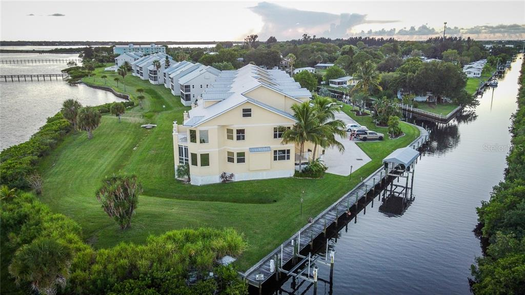 Located directly on the Myakka River, watch the sail boats, kayaks and other water vessels navigate to open waters. This community's fishing pier can be seen in the distance, top left. - Condo for sale at 4410 Warren Ave #511, Port Charlotte, FL 33953 - MLS Number is C7432222