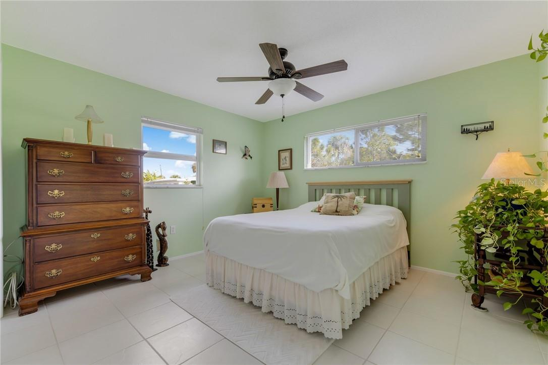 Sun filled bedroom 2 with canal views. Spacious, features ceramic tile flooring. - Single Family Home for sale at 24368 Blackbeard Blvd, Punta Gorda, FL 33955 - MLS Number is C7436898