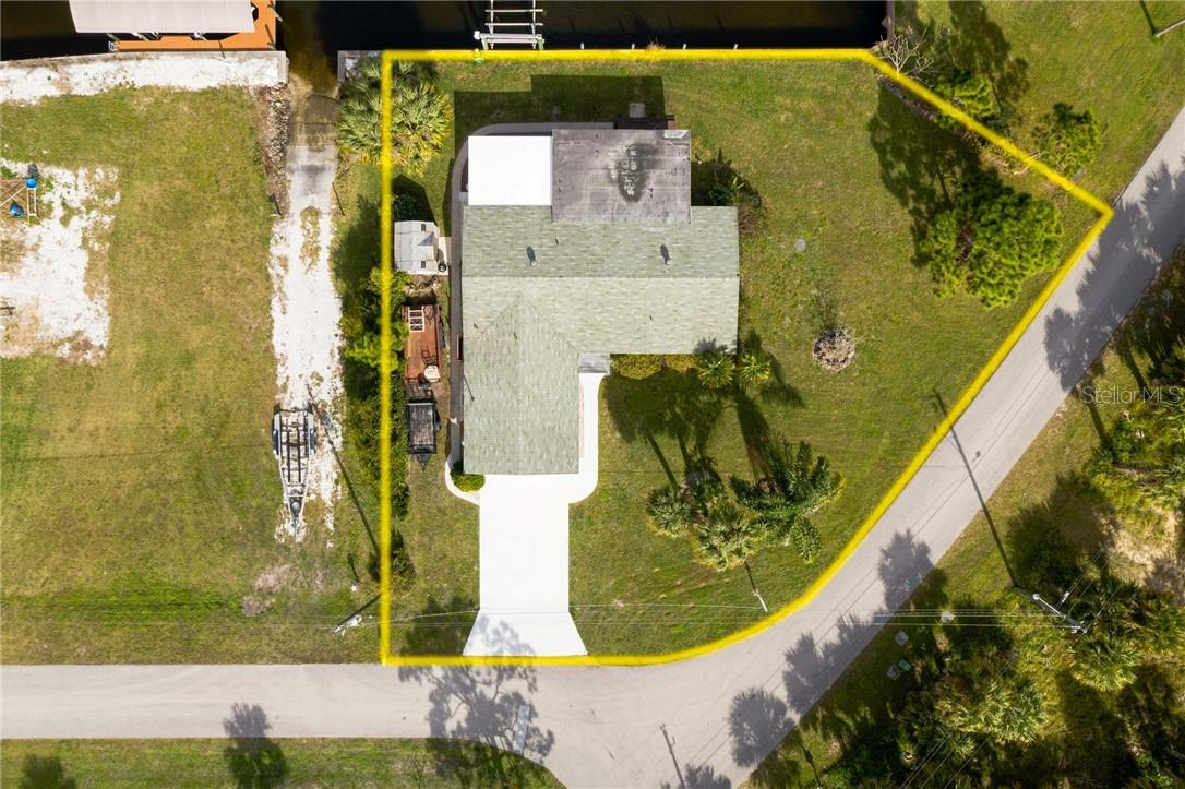 Corner location, oversized lot. No deed restrictions. Move in and start living the boaters dream. - Single Family Home for sale at 24368 Blackbeard Blvd, Punta Gorda, FL 33955 - MLS Number is C7436898