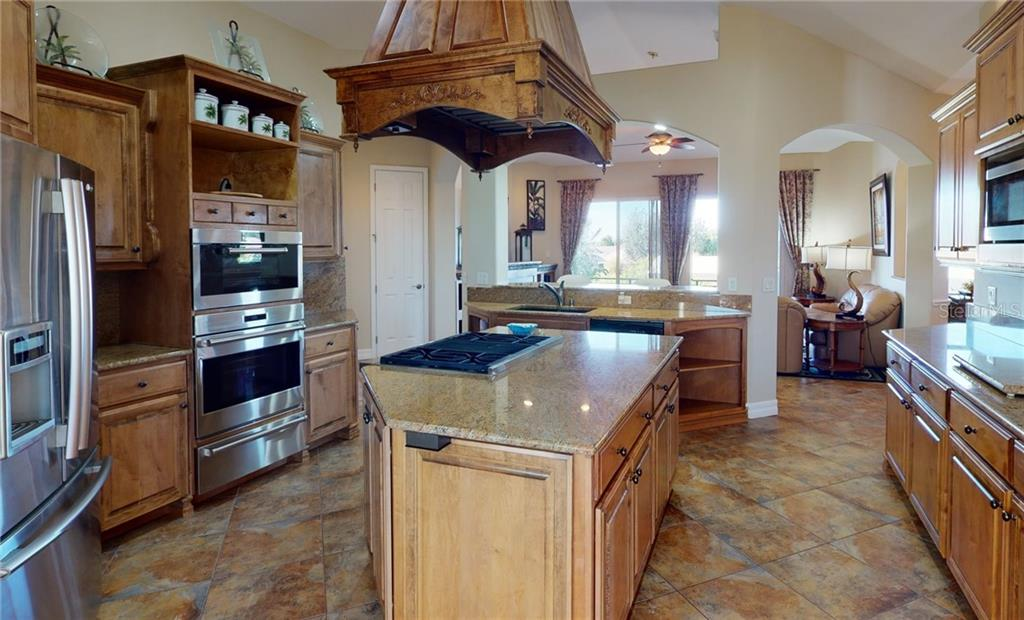2nd floor kitchen. - Single Family Home for sale at 4245 Spire St, Port Charlotte, FL 33981 - MLS Number is C7437570