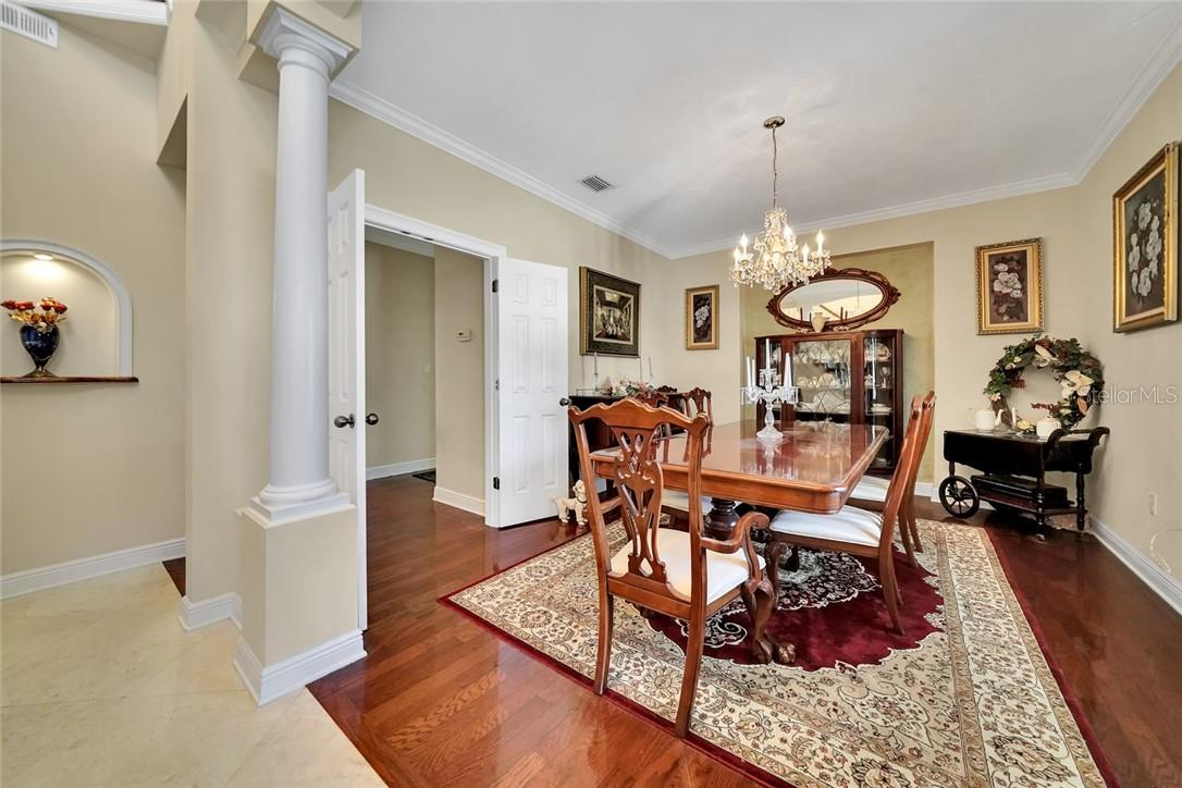 Formal Dining Room with access through double French Doors to the Gourmet Kitchen - Single Family Home for sale at 10230 Sw County Road 769, Arcadia, FL 34269 - MLS Number is C7437596
