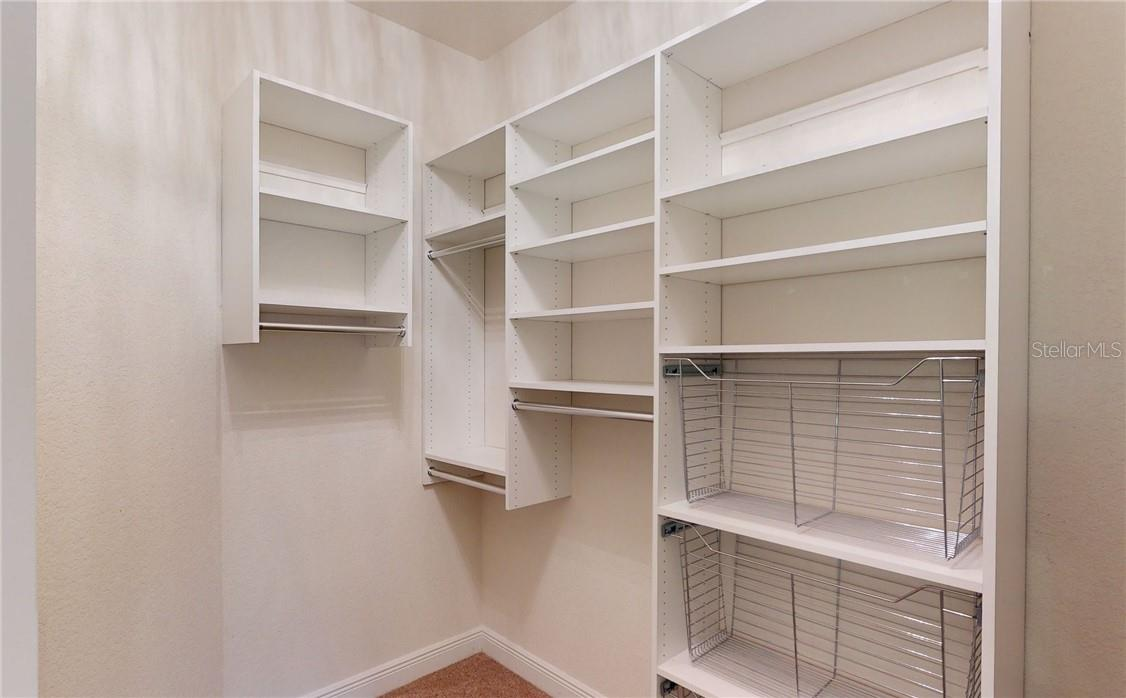 Second walk in closet from master bedroom with shelves. - Single Family Home for sale at 11905 Florence Ave, Port Charlotte, FL 33981 - MLS Number is C7441003