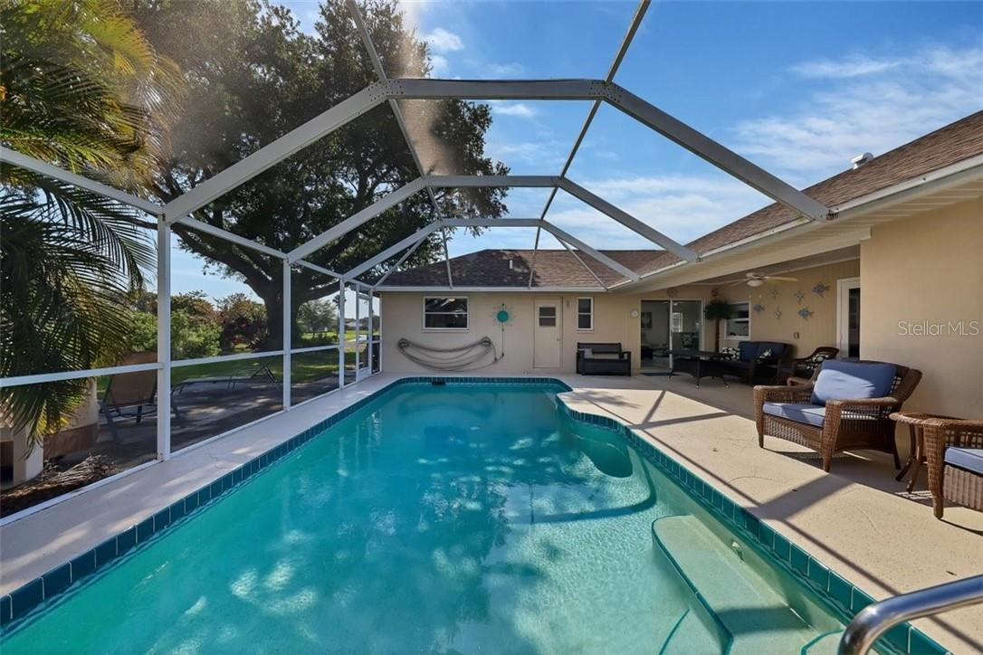 another view of pool to left of door at rear (bathroom2) is an outdoor shower as well - Single Family Home for sale at 116 Mariner Ln, Rotonda West, FL 33947 - MLS Number is C7441260