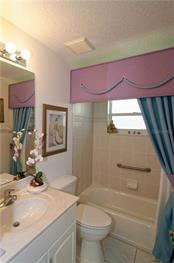 Guest Bathroom has a tub and shower. - Single Family Home for sale at 9199 Key West St, Port Charlotte, FL 33981 - MLS Number is C7403206