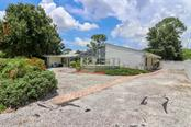 R.V. parking  and hook up to right with #2 private entrance - Single Family Home for sale at 3262 Great Neck St, Port Charlotte, FL 33952 - MLS Number is C7403390