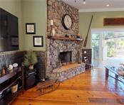 Family room with wood burning fireplace w/ a gas starting log, Tennessee stone & Walnut Mantel. - Single Family Home for sale at 1289 Casper St, Port Charlotte, FL 33953 - MLS Number is C7407177