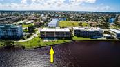 Location, location, location.  This waterfront location is spectacular! Watch the waterfowl, marine life, boaters and sailors all enjoying Mother Nature's gifts. - Condo for sale at 1601 Park Beach Cir #112 / 2, Punta Gorda, FL 33950 - MLS Number is C7407435