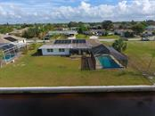 New concrete seawall & solar pool heat on western facing slope - Single Family Home for sale at 126 Bangsberg Rd Se, Port Charlotte, FL 33952 - MLS Number is C7409866