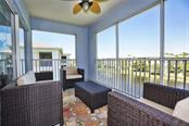 Lanai overlooking pond and fountain - Condo for sale at 8405 Placida Rd #401, Placida, FL 33946 - MLS Number is C7414726