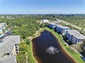 Aerial of pond and fountain in the complex - Condo for sale at 8405 Placida Rd #401, Placida, FL 33946 - MLS Number is C7414726
