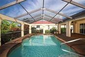 Virtually Staged: Owner suite with stacking slider to Lanai & Pool - Single Family Home for sale at 2713 Saint Thomas Dr, Punta Gorda, FL 33950 - MLS Number is C7417491
