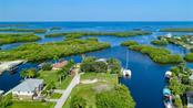 Pirate Harbor has evolved to be one of the premiere waterfront areas in Punta Gorda - brand new homes line this street and surrounding streets. - Vacant Land for sale at 24166 Henry Morgan Blvd, Punta Gorda, FL 33955 - MLS Number is C7417999