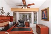 Office/Den is located at one end of the galley kitchen and features nice pool views. - Single Family Home for sale at 1633 Islamorada Blvd, Punta Gorda, FL 33955 - MLS Number is C7418555