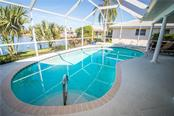 Enjoy the canal view from your pool and large screened lanai. - Single Family Home for sale at 1440 Appian Dr, Punta Gorda, FL 33950 - MLS Number is C7425399