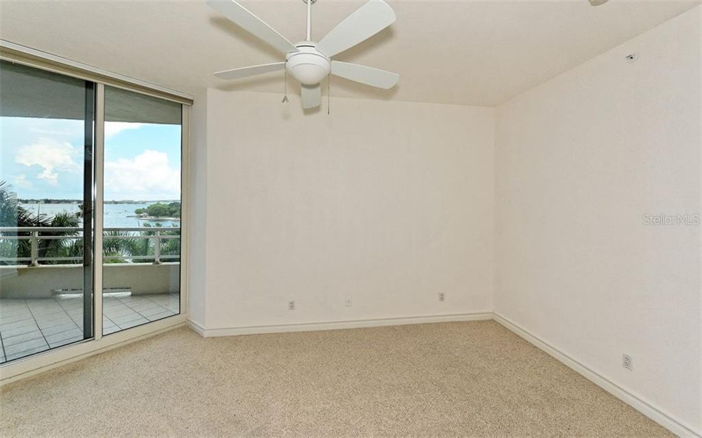 2nd bedroom with sliders to terrace with Bay views - Condo for sale at 500 S Palm Ave #41, Sarasota, FL 34236 - MLS Number is A4144835