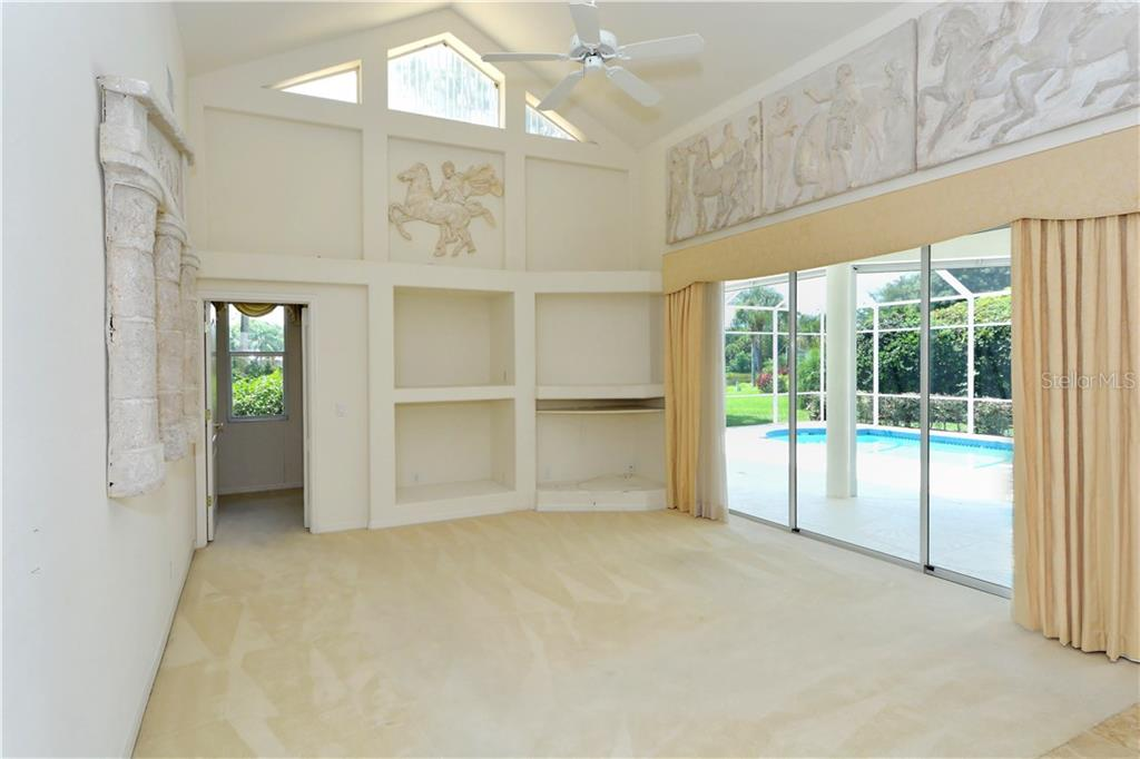 Vaulted ceiling, triple sliders and well-placed high windows bathe this home with sunshine. The door to the left opens into an additional guest suite (4th bedroom with direct access to the pool bath.) - Single Family Home for sale at 8753 Merion Ave, Sarasota, FL 34238 - MLS Number is A4165409
